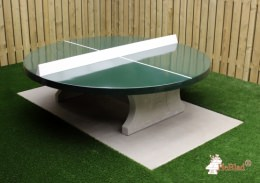 Ping-pong table round with green playing surface